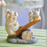 Pigs and seesaw decorative display article