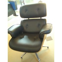 Walnut Eames style lounge chair and ottoman in black Italian leather