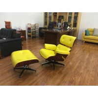 Yellow Eames style lounge chair and ottoman in Italian leather and Walnut veneer