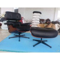 Tigerwood Eames style lounge chair and ottoman in black Italian leather