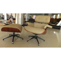 Grey color Eames style lounge chair and ottoman in Italian leather and Tigerwood