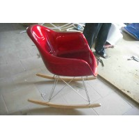 Eames Style armed rocking chair rocker in fiberglass