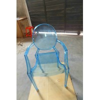 Ghost chair with arms in transparent blue color